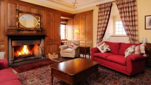 Cosy sitting room with open fire