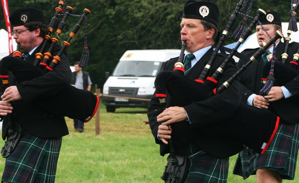 Listen to the pipers in the pipe band. Copyright Scotts Castle Holidays