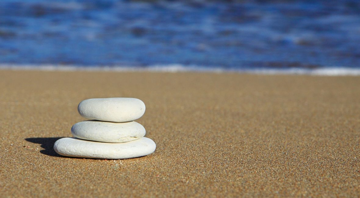 pebbles balanced on the beach