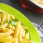 cooked pasta in green bowl