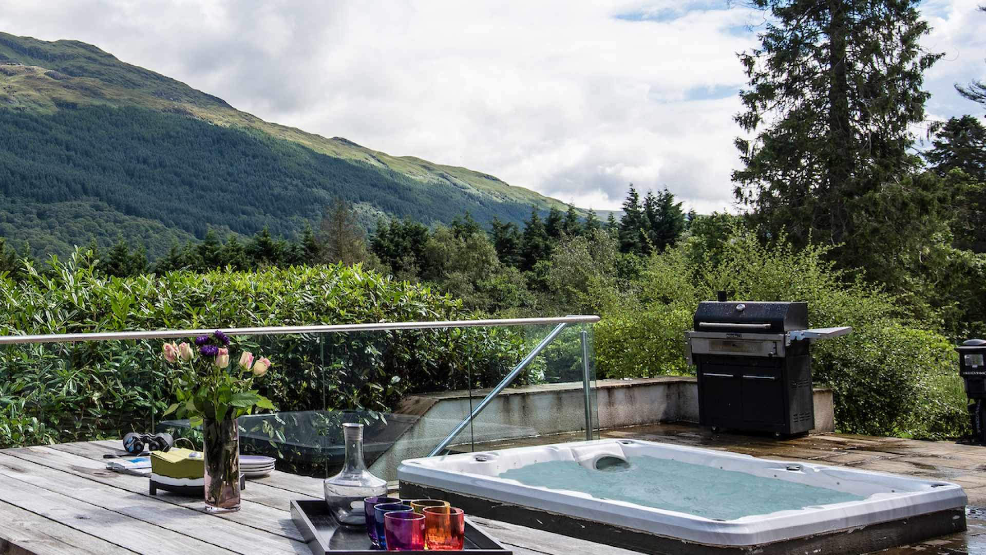 This hot tub is surrounded by stunning Scottish scenery overlooking Loch Lomond