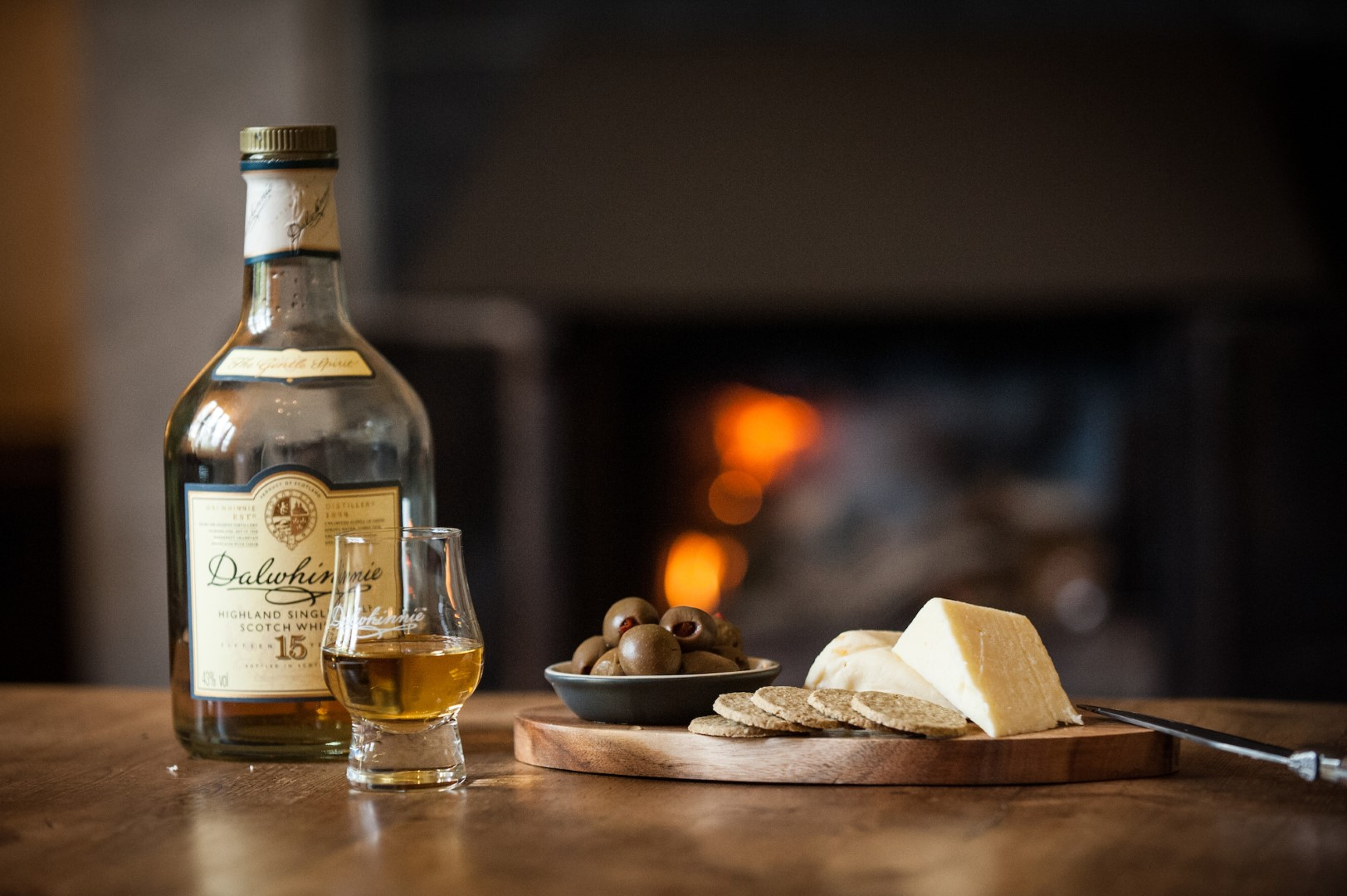 Dalwhinnie whisky with cheese and biscuits by the fire