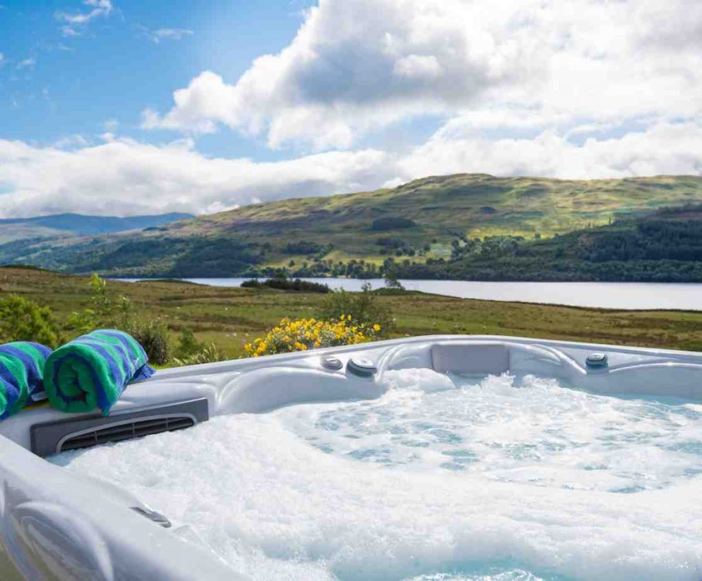 Scottish hunting lodge with loch views from the hot tub